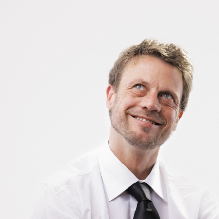 good business: Happy mature businessman looking away