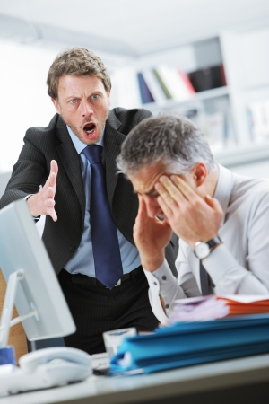 bad leadership: Mature manager shouting at his office worker