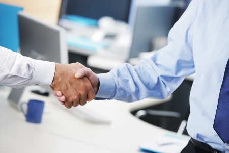 Handshake business: Business deal. Close up of a handshake