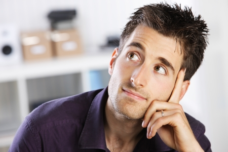 man thinking: Portrait of a casual young man thinking