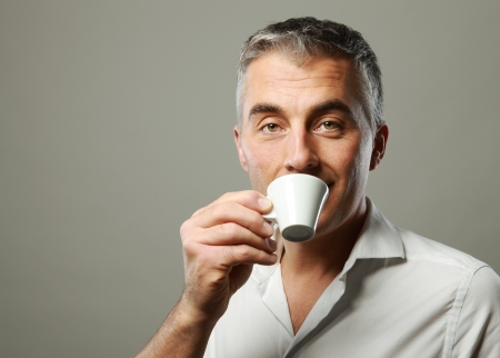 and the horizontal man: Handsome mature man enjoying a hot drink