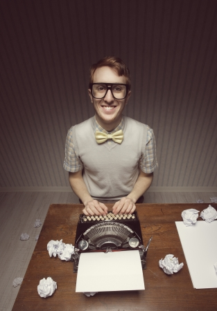 Nerd student journalist and his typewriter