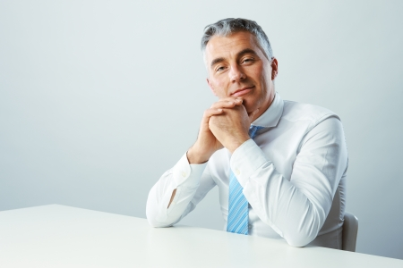 mature business man: Portrait of a handsome mature man smiling Stock Photo