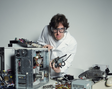 Portrait of a Computer technician with a computer destroyed Stock Photo - 20143183