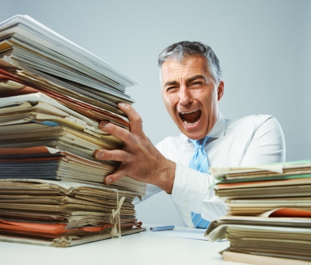 Overworked mature business man screaming in anger photo