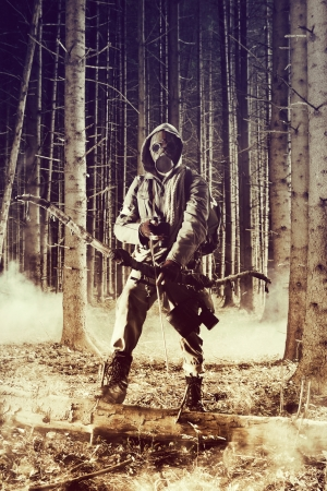 Soldier wearing a gas mask is fighting for its survival photo