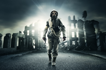 apocalyptic: Post apocalyptic survivor in gas mask, destroyed city in the background Stock Photo