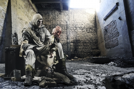 Soldier with an old doll in hand in the ruins photo