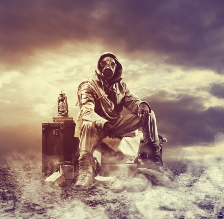 natural disaster: Environmental disaster. Post apocalyptic survivor in gas mask Stock Photo