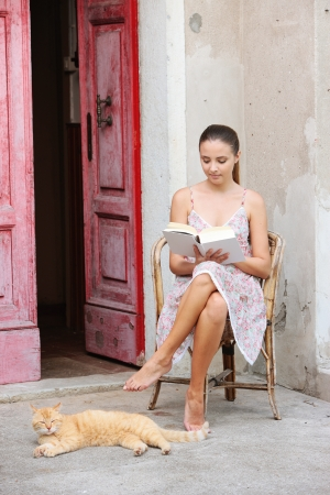 Beautiful girl reading a book outdoors enjoying a summer day Stock Photo - 20569873