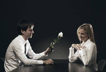 Man in love gives a rose to his girlfriend photo