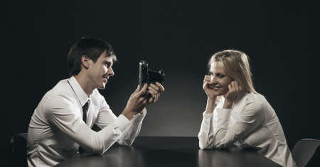 Young Man Photographing Girlfriend photo