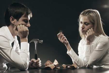 Portrait of young couple unhappy about their savings  photo