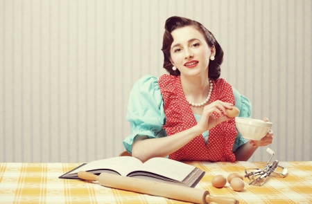 Vintage portrait of a housewife in the kitchen photo