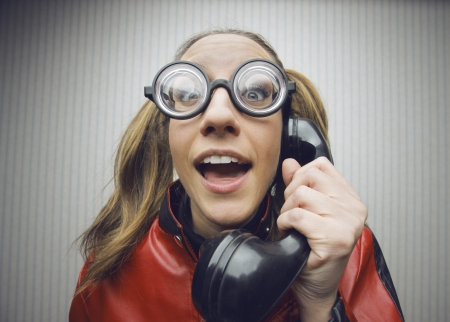 funny nerd humor woman talking retro vintage black telephone on vintage wallpaper photo