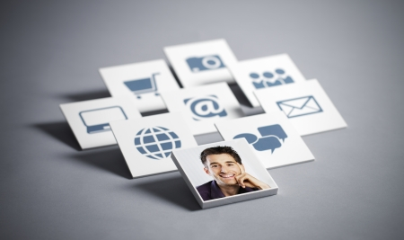 Portrait of young smiling man with tecnology icons photo