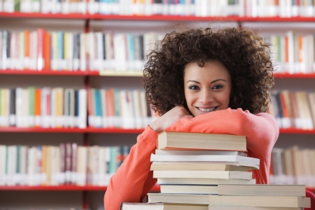 Portrait of cheerful female student in library photo