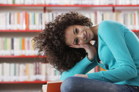 library student: Portrait of female student in library Stock Photo