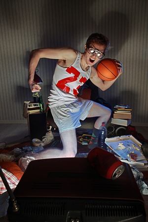 Nerdy excited basketball fans watching television celebrating the victory Stock Photo - 21772322