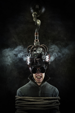 coercive: Man wearing a brain-control helmet, human brain-related experiments Stock Photo