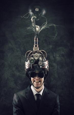 coercive: Cheerful businessman wearing a brain-control helmet