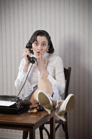 Retro Business Woman talking on phone at desk photo