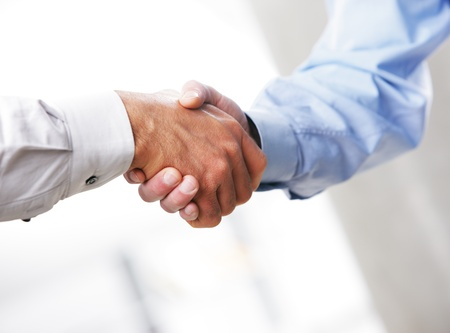 business handshake: Business deal. Close up of a handshake