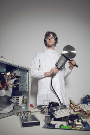 Bizarre computer technician with a circular saw Stock Photo - 21772453