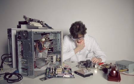 Computer technician is trying to repair a computer  photo