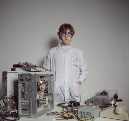 Portrait of a Computer technician with a computer destroyed Stock Photo - 21772486