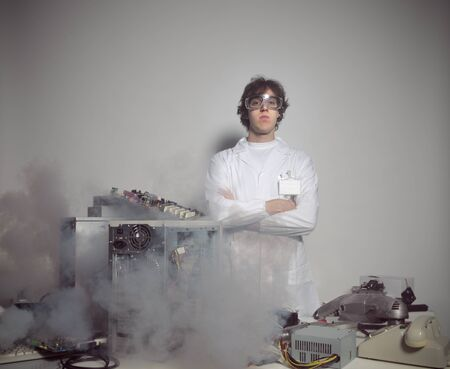 Portrait of a Computer technician with a computer destroyed photo