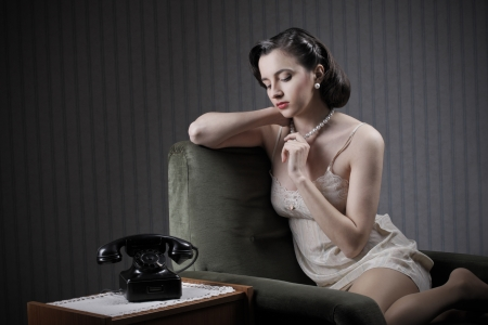 Woman wearing lingeriee waiting for the phone to ring Stock Photo - 21772496
