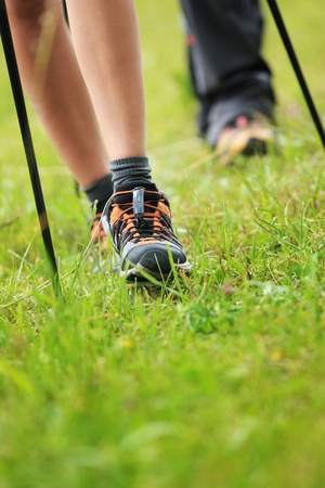 nordic walking: Woman hiking in forest Stock Photo