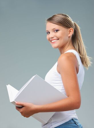 Portrait of beautiful girl holding a white book Stock Photo - 22238323