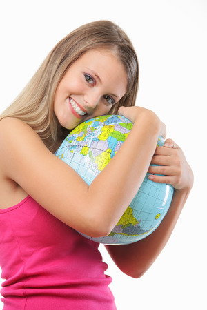 Portrait of a happy blonde girl embracing a globe against white background Stock Photo - 22238362