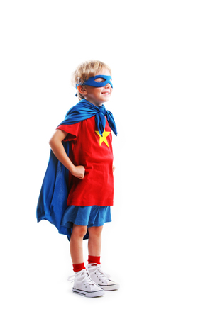 crime fighter: A young boy dreams of becoming a superhero, white background Stock Photo