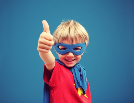 crime fighter: A young boy hero giving you a thumbs up Stock Photo