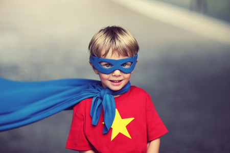 cool kids: A young boy dreams of becoming a hero. Stock Photo