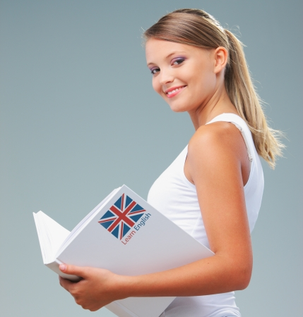 english girl: English female student holding a book Stock Photo