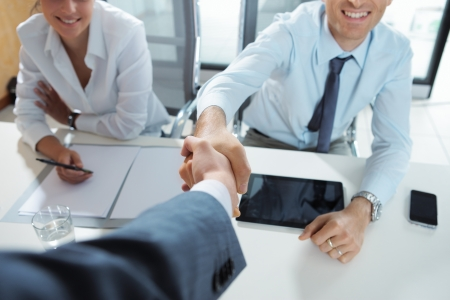 job satisfaction: Businessman being welcomed into the company by his new colleagues