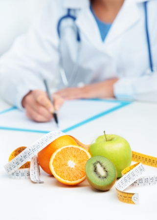 dietology: Nutritionist Doctor is writing a prescription. Focus on fruit