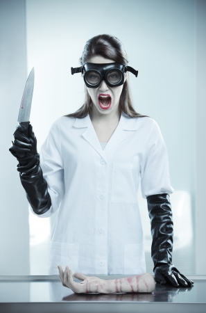 terrifying: A terrifying doctor holding a knife and shouting