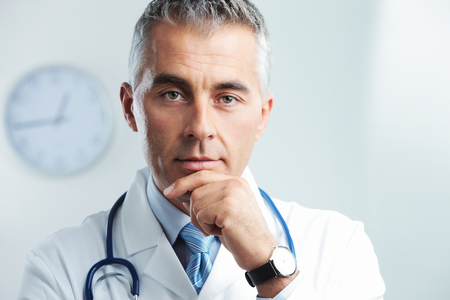 male doctor: Portrait of a handsome male doctor Stock Photo