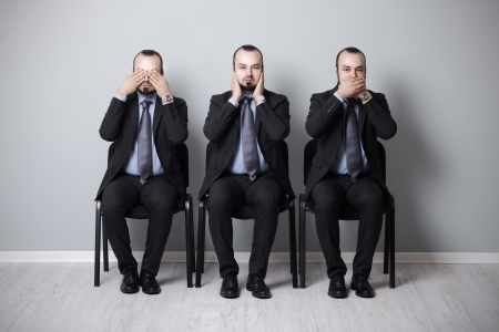 three wise businessman that they didnt hear, speak and see. photo