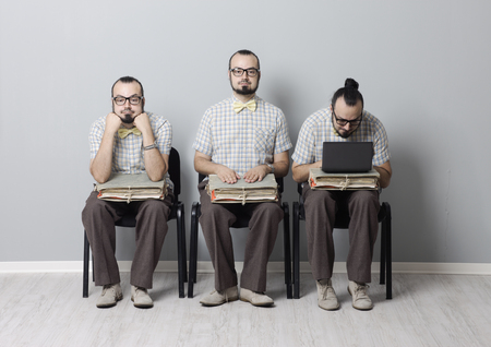Conceptual image of three men waiting for an interview  photo