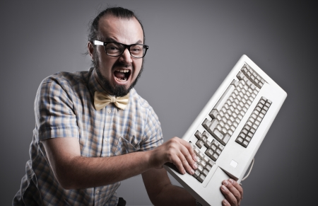 angry man: Angry man is destroying a keyboard Stock Photo