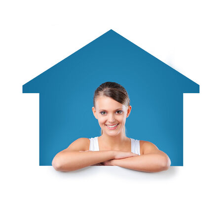conceptual cute: Attractive young woman looking through House sign