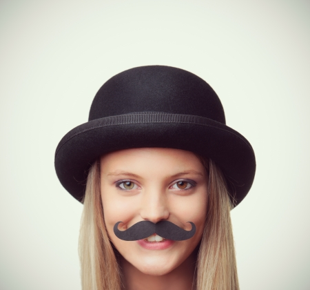 Blonde girl with mustache looking at camera photo