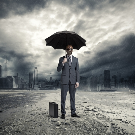 doomsday: A businessman wearing a gas mask, standing in the rain