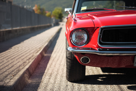 old fashioned car: American muscle car convertible on the road, cropped image Stock Photo